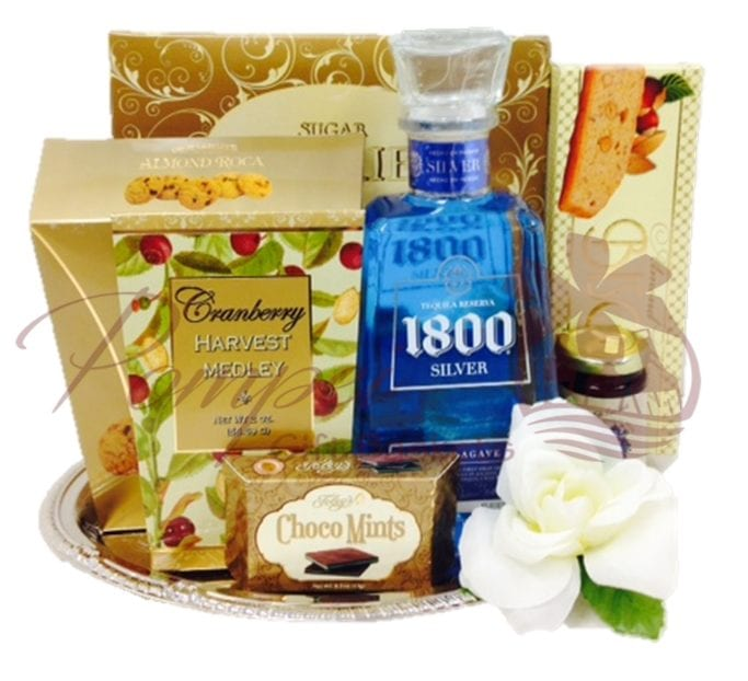 Something Blue Tequila Gift Basket with 1800 Silver Tequila and sweet snacks on a silver tray